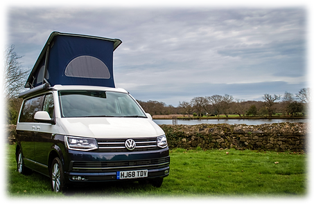 VW Campervan with its roof elevated