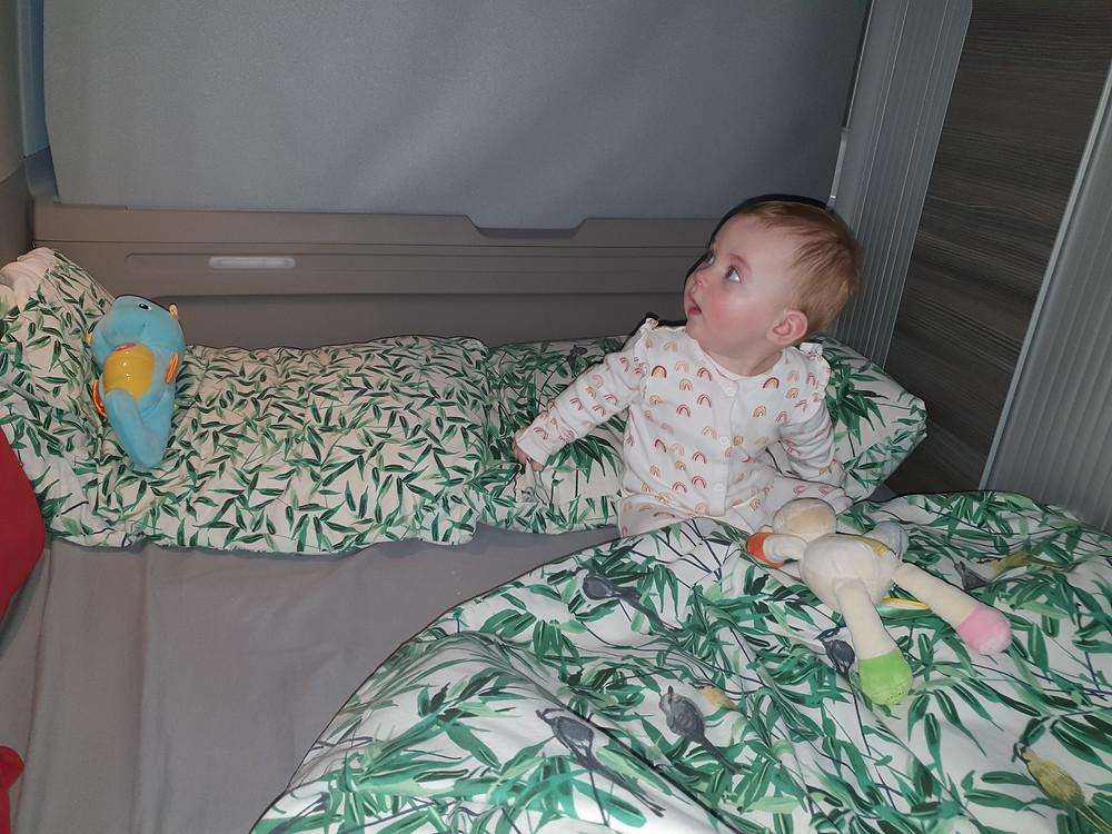 Baby sleeping in a campervan