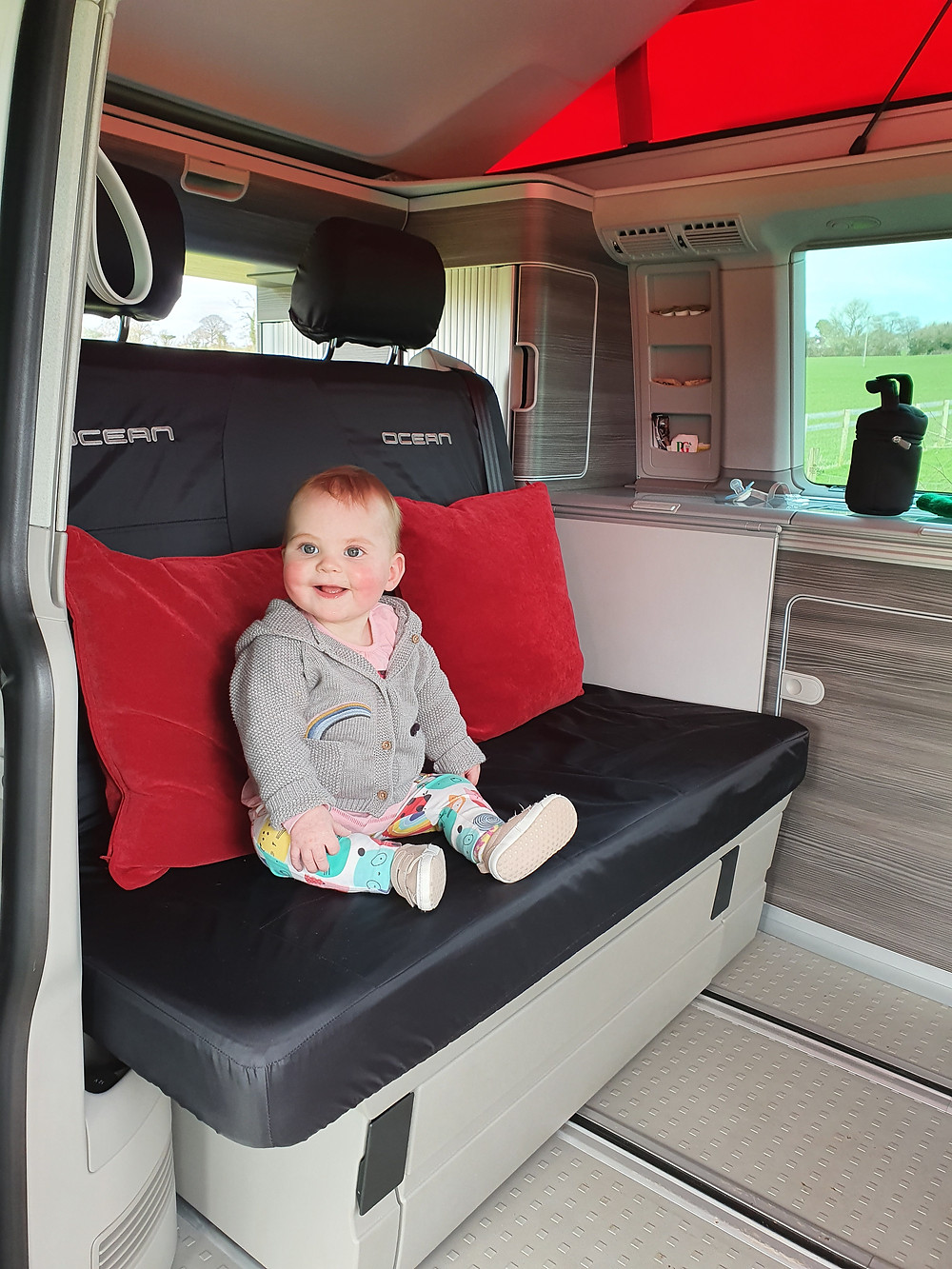 Baby sitting in a campervan