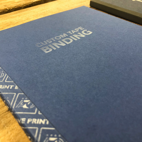 Close up of tape bound booklet