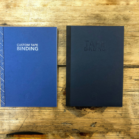 Twin tape bound booklets