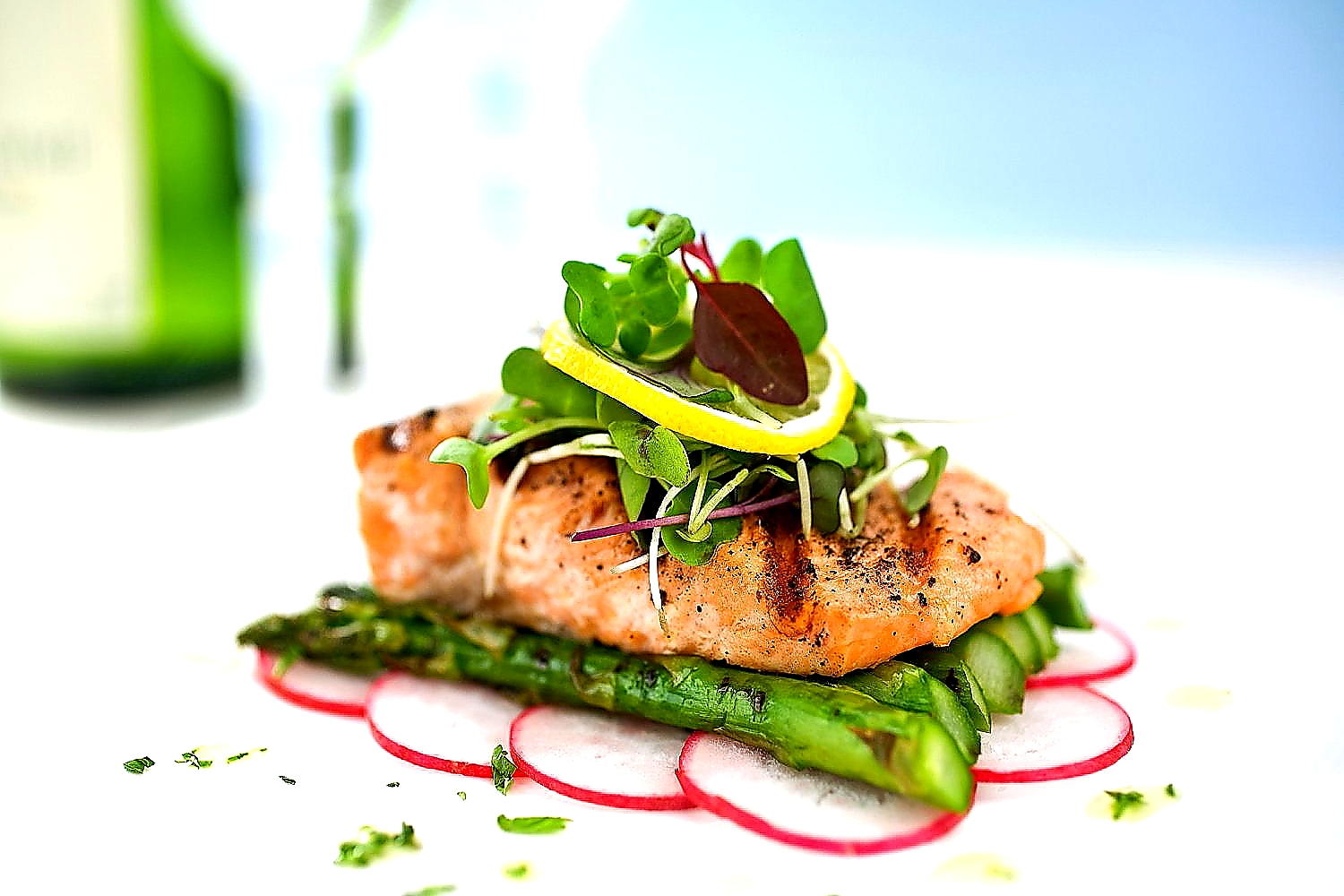salmon on bed of asparagus