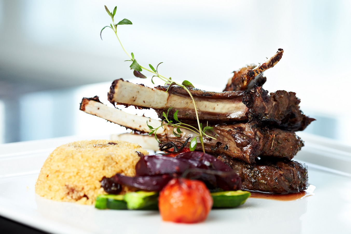 Lamb chop on bed of couscous