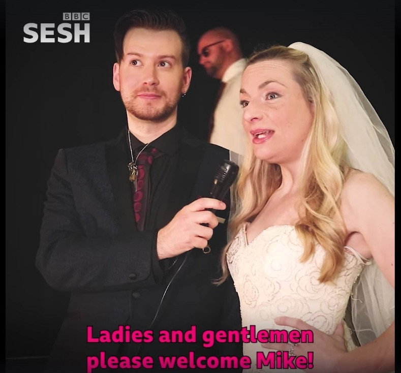 "Amy Webber and Comedy Geek collaborator Stefan Pejic in the BBC Sesh video ""When You're Single at a Wedding"""