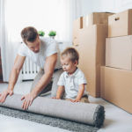 moving-concept-father-and-son-moving-to-