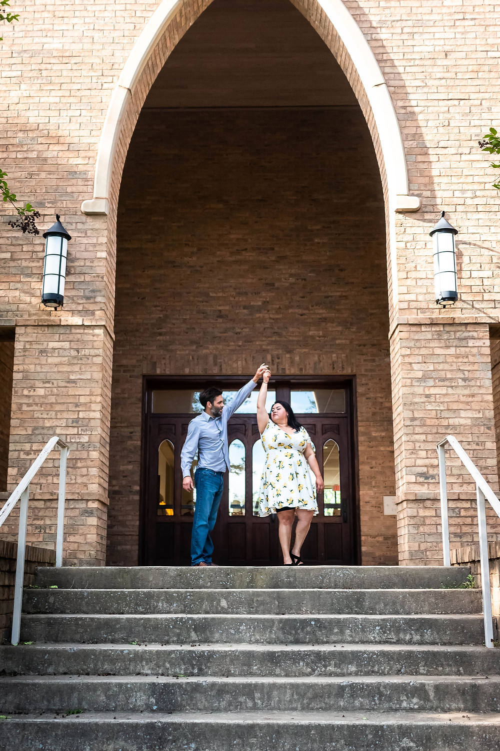 Cute couple dance on steps of historic church in downtown Murfreesboro