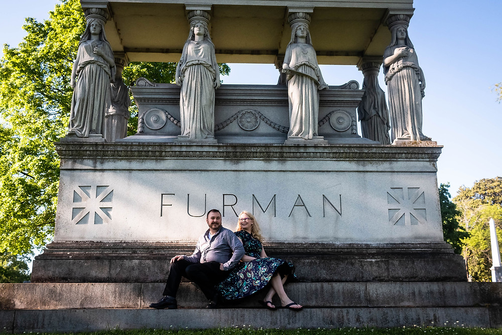 Cute couple seated on mausoleum at Mt. Olivet Cemetery