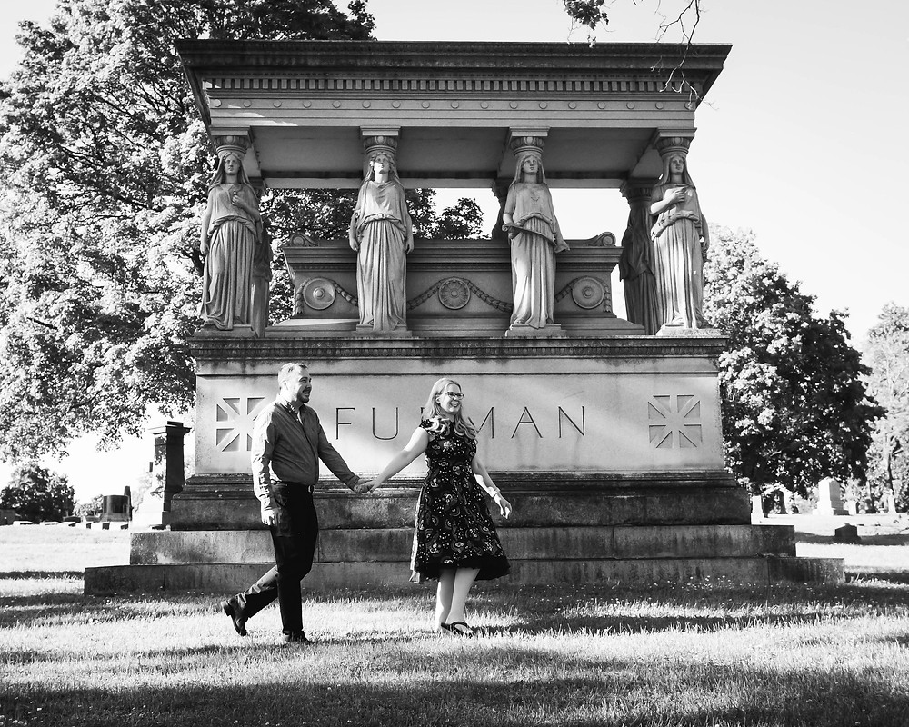 Black and white cute couple wander through cemetery  at Mt. Olivet Cemetery