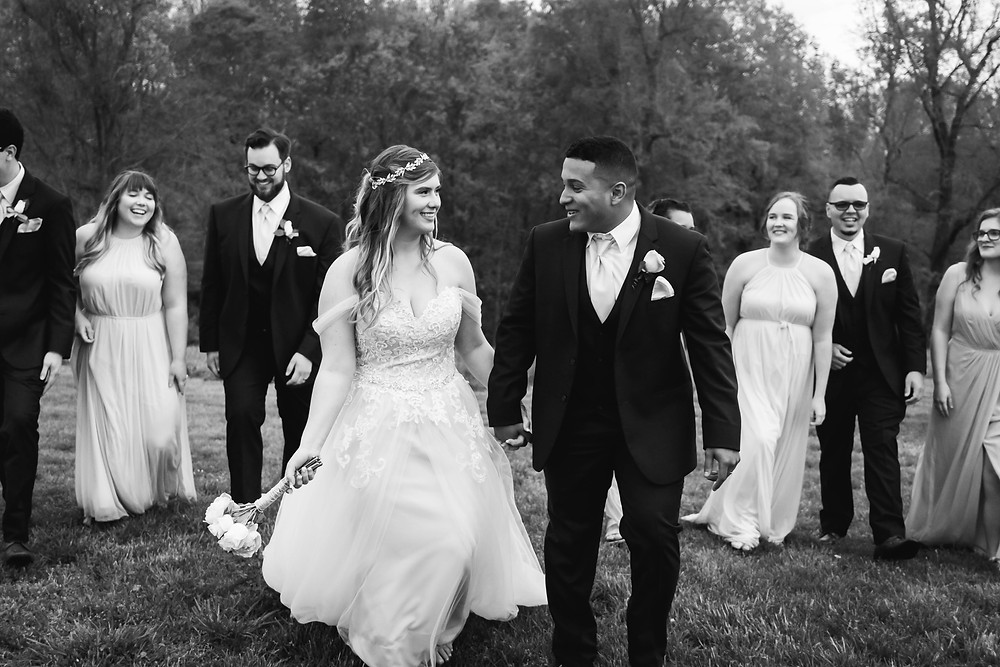 Black and white bridal party walking at Owen Farm