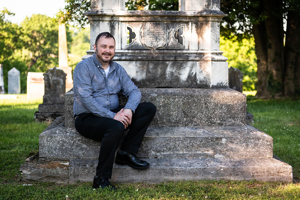 Handsome man sits in cemetery at Mt. Olivet Cemetery