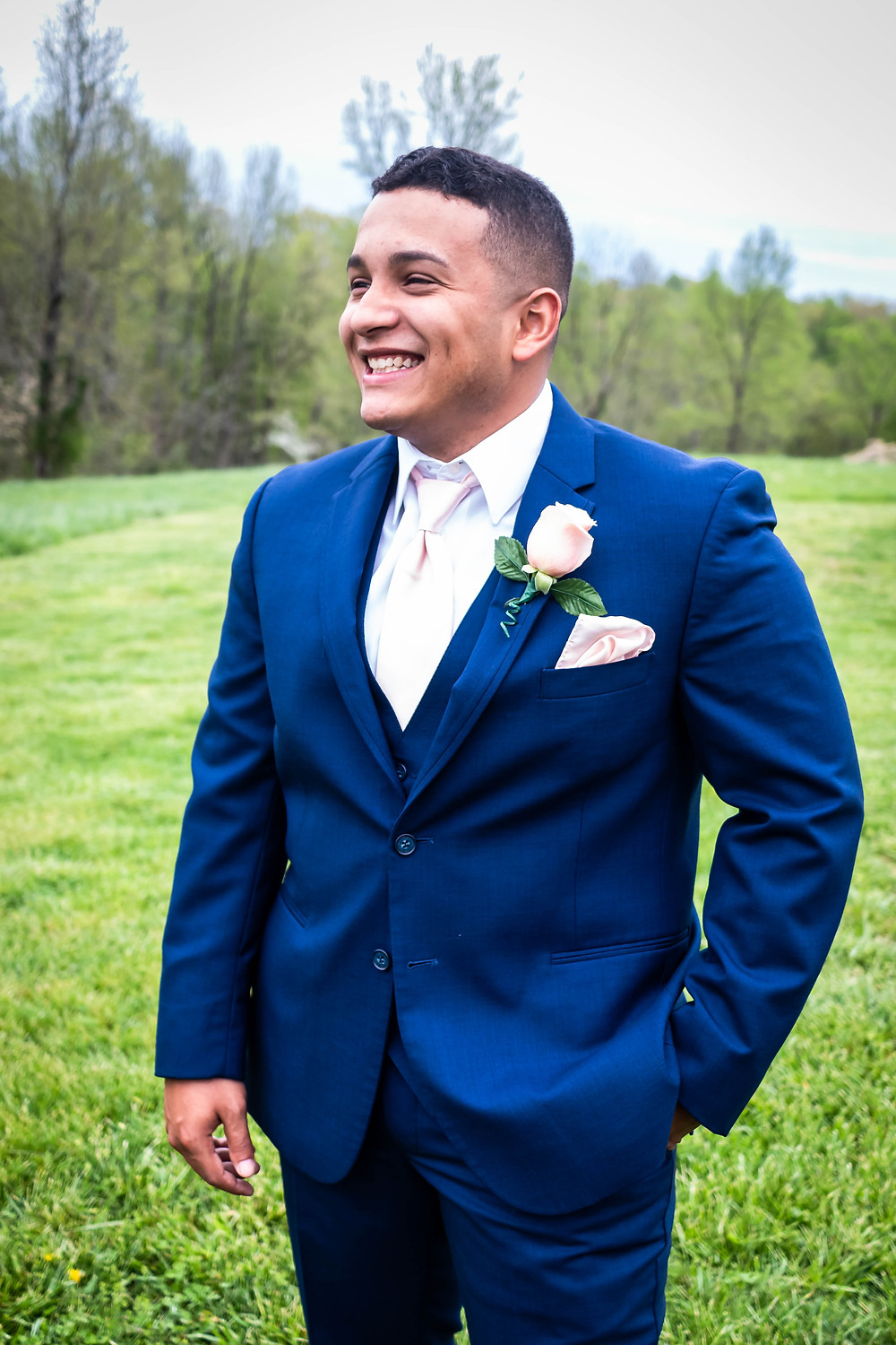 Groom portrait with navy suit at Owen Farm