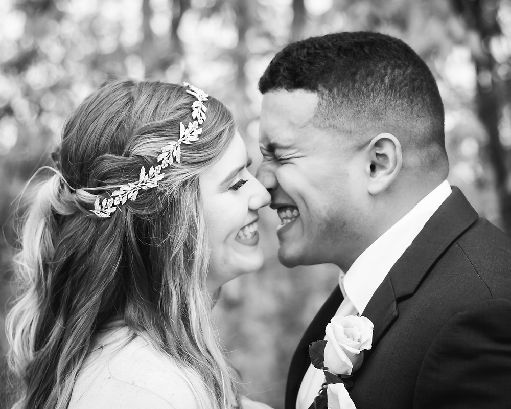 Black and white bride and groom smile big at Owen Farm