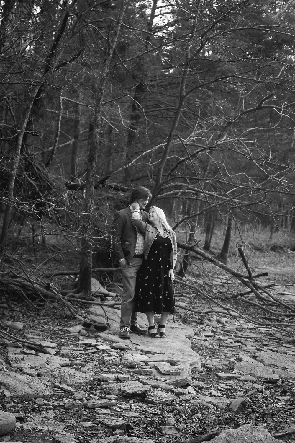 Black and white cute couple pose on a rock  at Long Hunter State Park