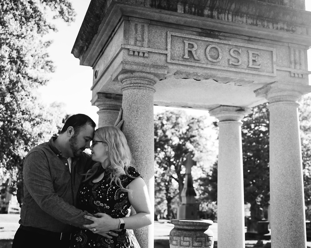 Black and white cute couple share a quiet moment in a cemetery at Mt. Olivet Cemetery