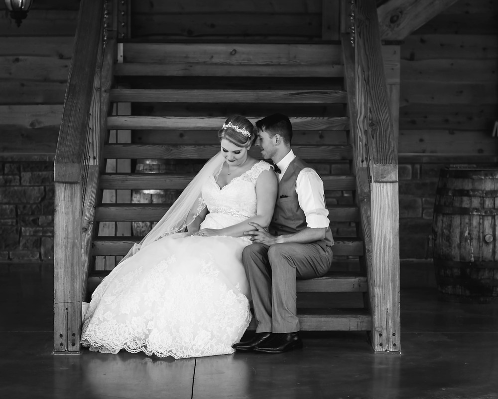 Black and white bride and groom share a special moment at Sycamore Farm