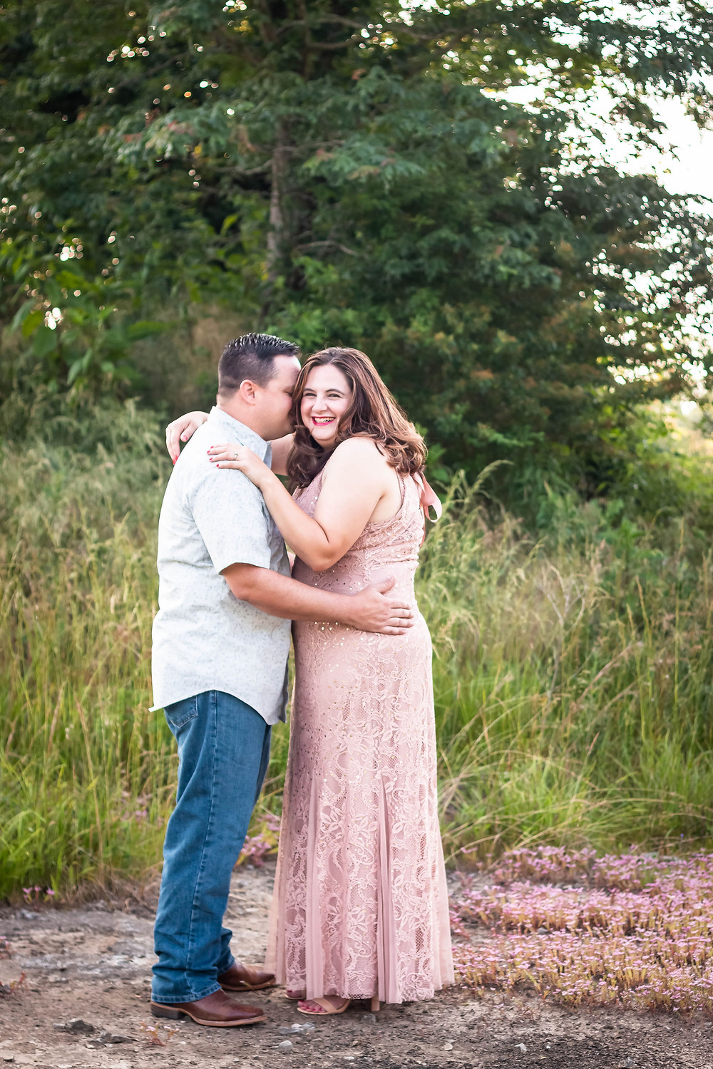 Cute couple laughing in a field in Lewisburg, Tennessee