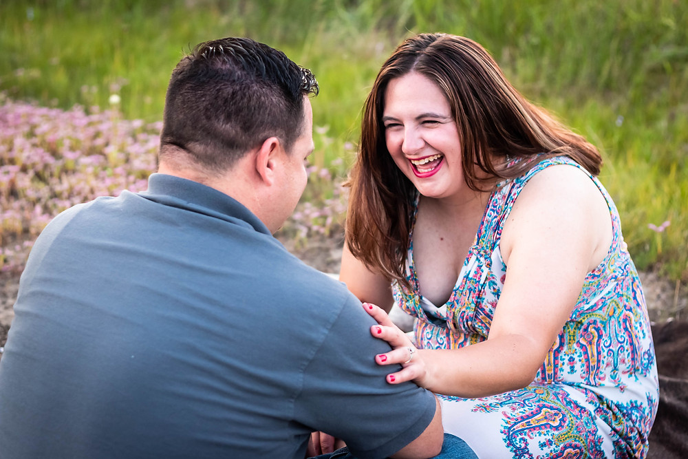 Cute couple sharing a laugh in a field in Lewisburg, Tennessee