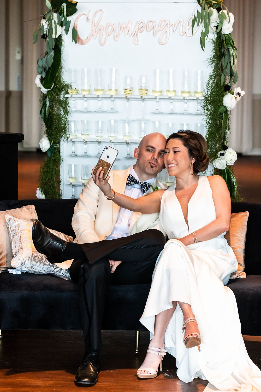 Bride and groom pause for selfie at wedding reception at Noah Liff Opera Center