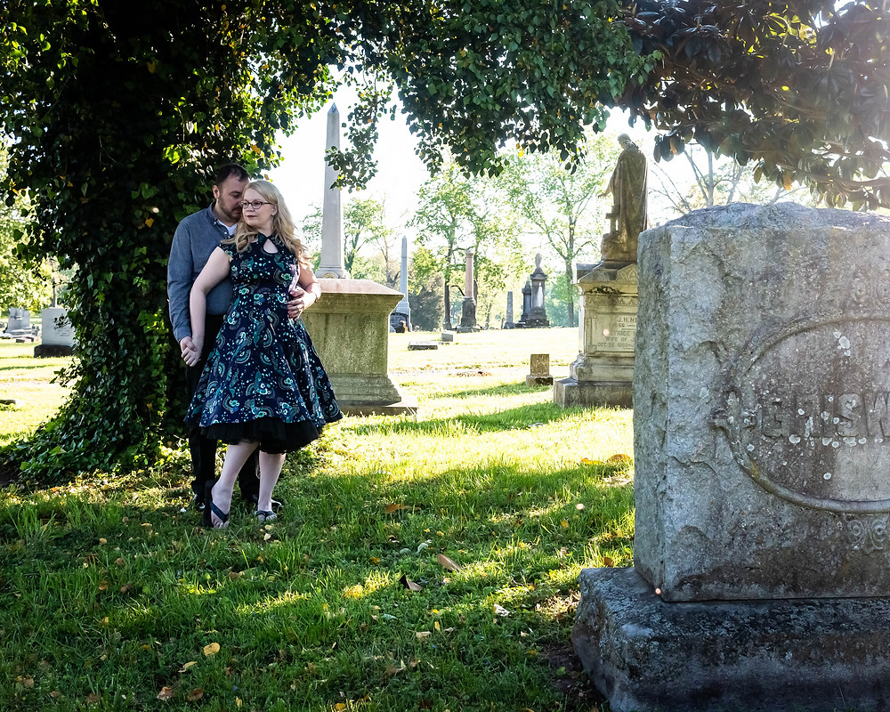 Cute couple share a moment in cemetery at Mt. Olivet Cemetery