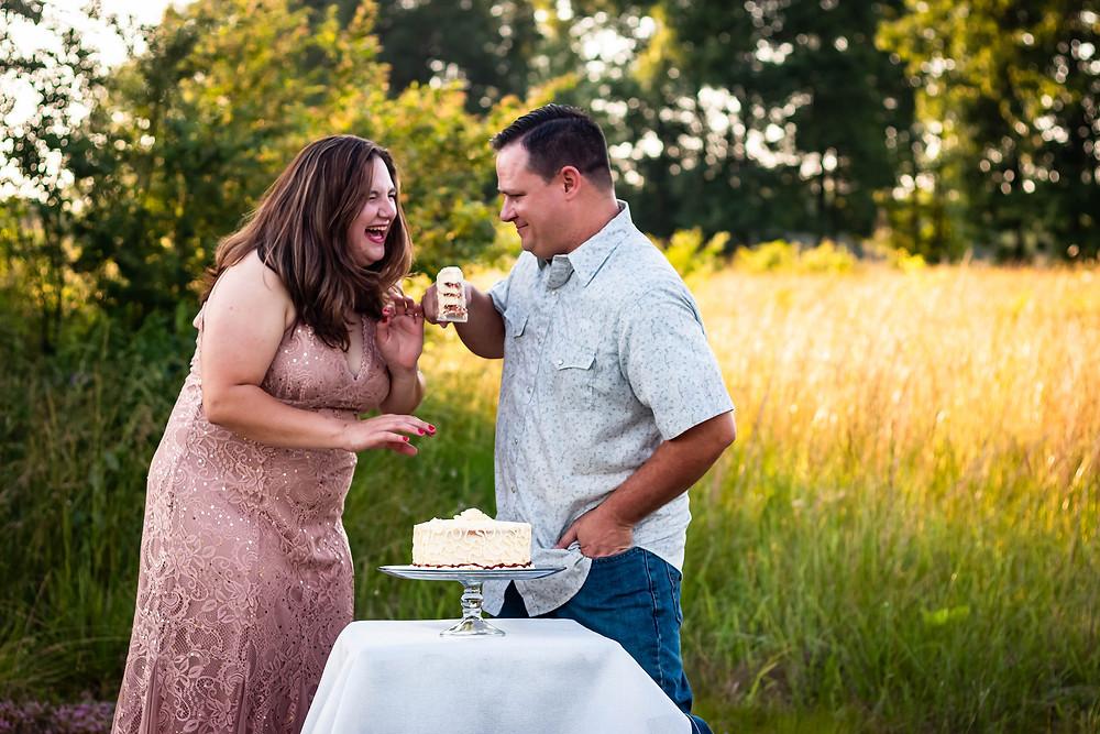 Cute couple cut cake in field in Lewisburg, Tennessee