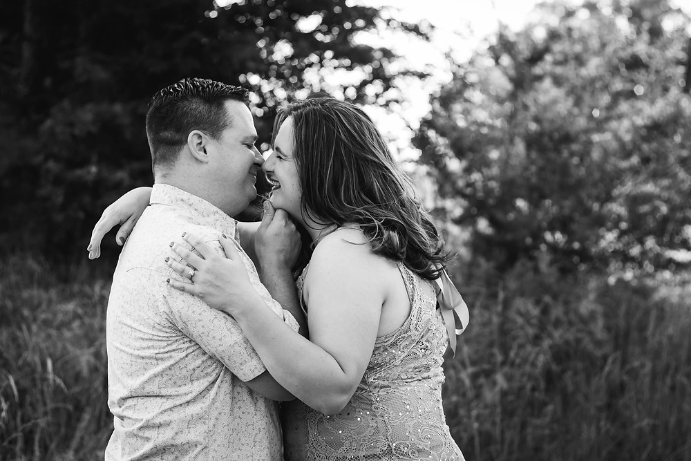 Black and white cute couple go in for a kiss in Lewisburg, Tennessee