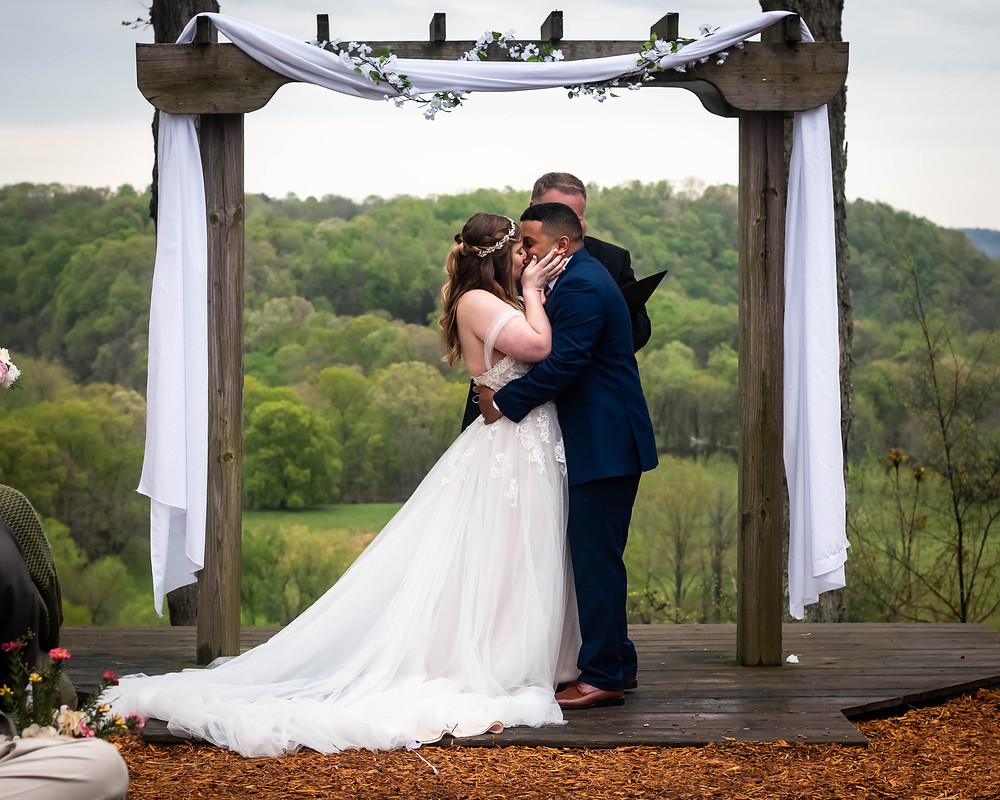 Bride and groom share first kiss with Tennessee mountains at Owen Farm