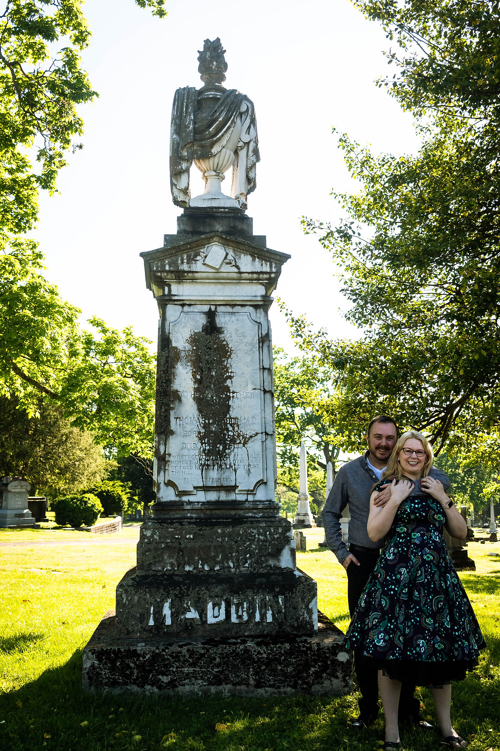 Cute couple pose in cemetery at Mt. Olivet Cemetery