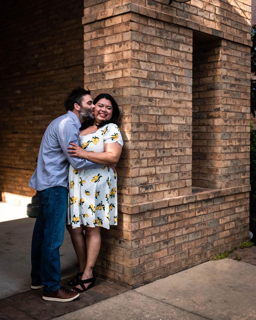 Cute man kisses girl at historic church in downtown Murfreesboro