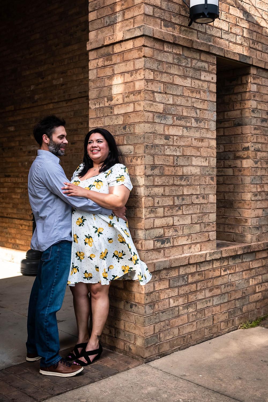 Cute couple lean against historic church in downtown Murfreesboro