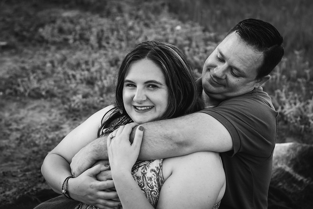 Black and white cute couple snuggled up in a field in Lewisburg, Tennessee