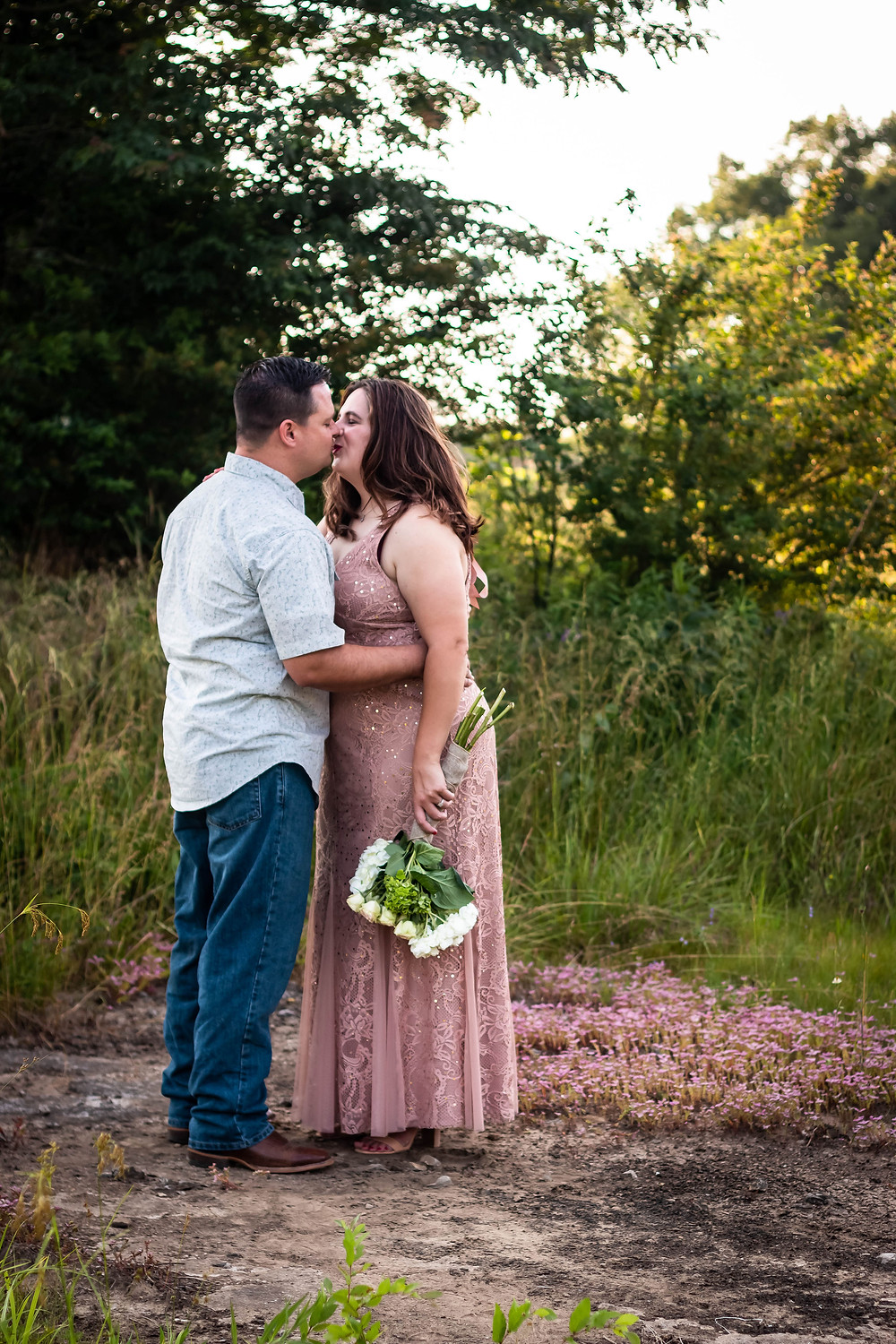 Cute couple share a kiss in a field in Lewisburg, Tennessee