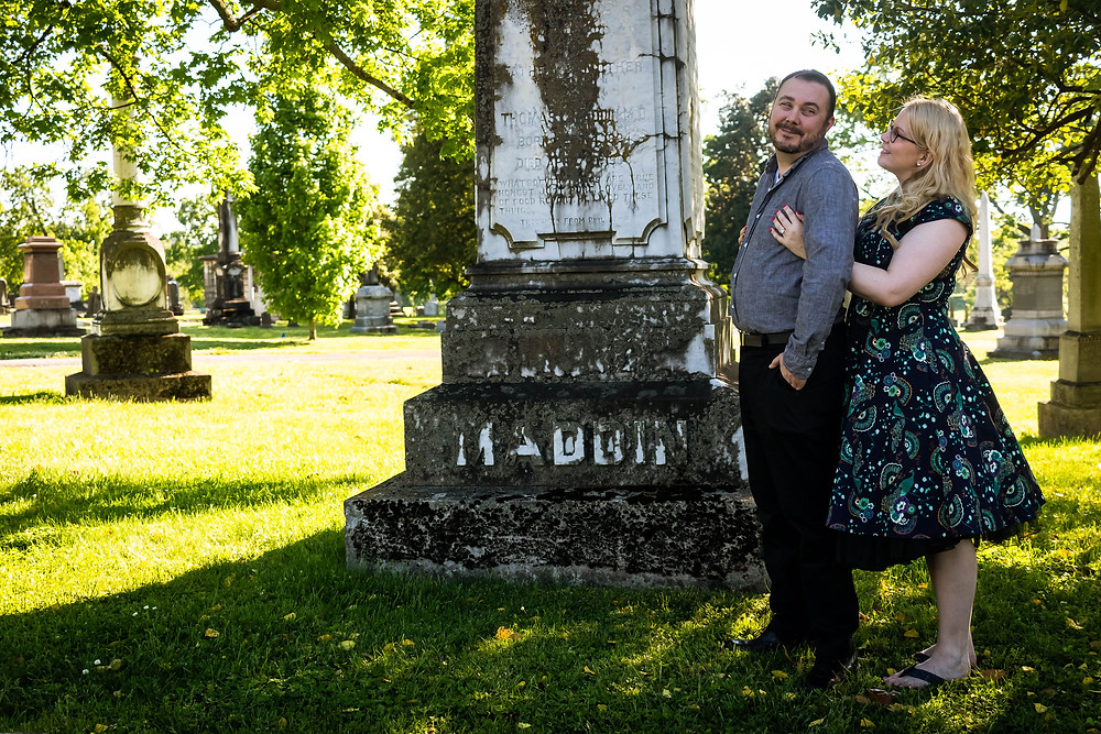 Cute couple share a moment in a cemetery at Mt. Olivet Cemetery