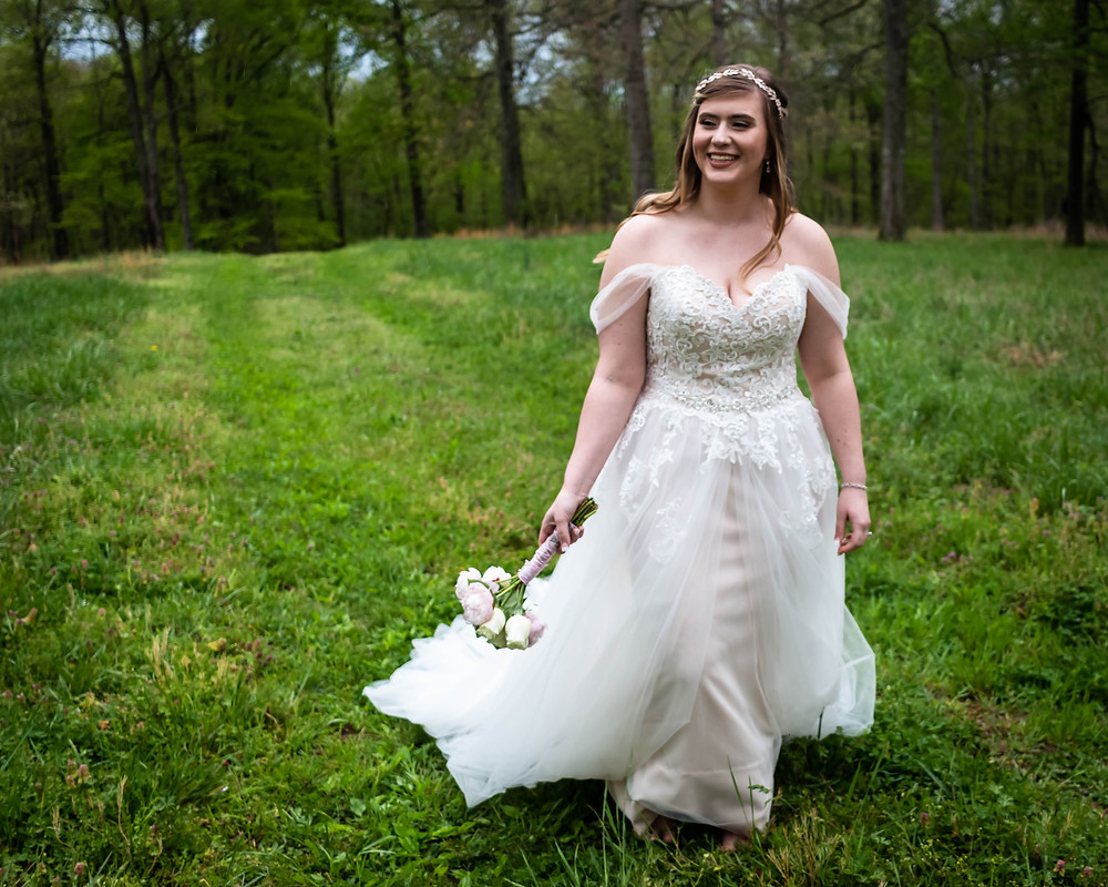 Bride walking through field at Owen Farm