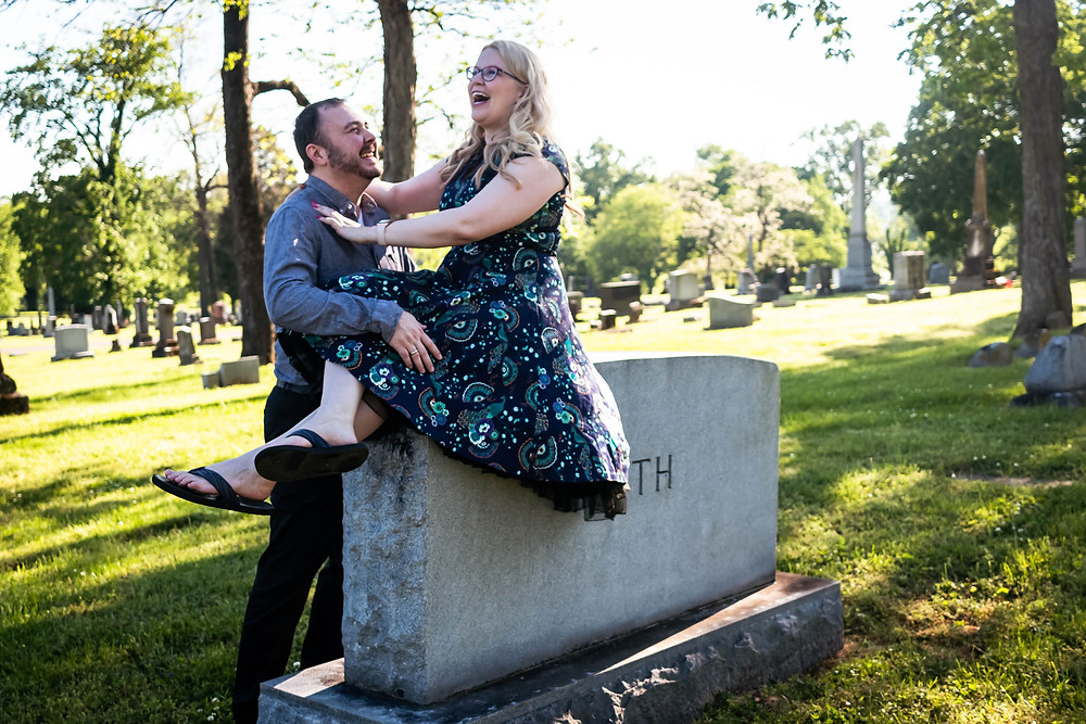 Cute couple share a laugh on headstone at Mt. Olivet Cemetery
