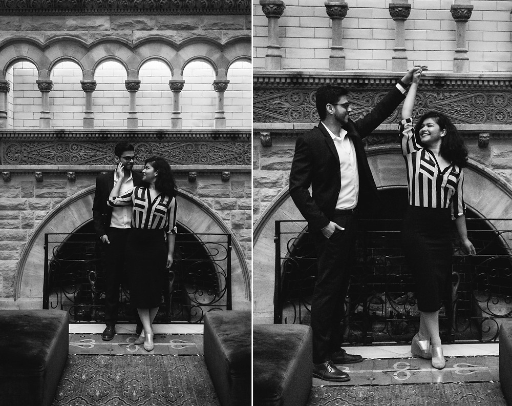 Black and white couple goof around at Union Station Hotel