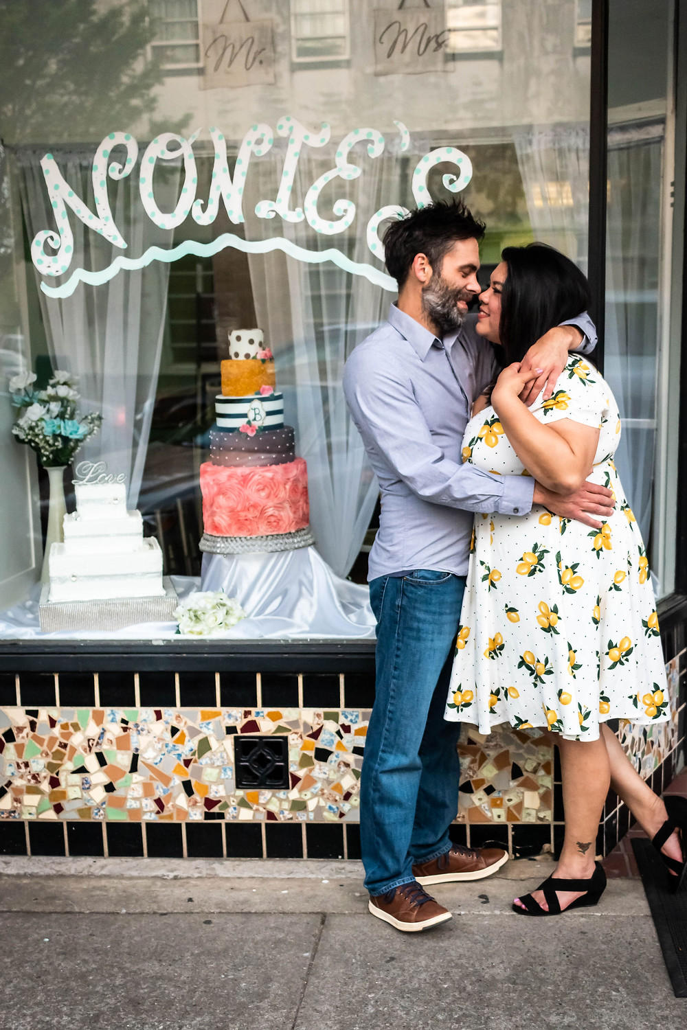 Cute couple poses in front of candy shop in downtown Murfreesboro