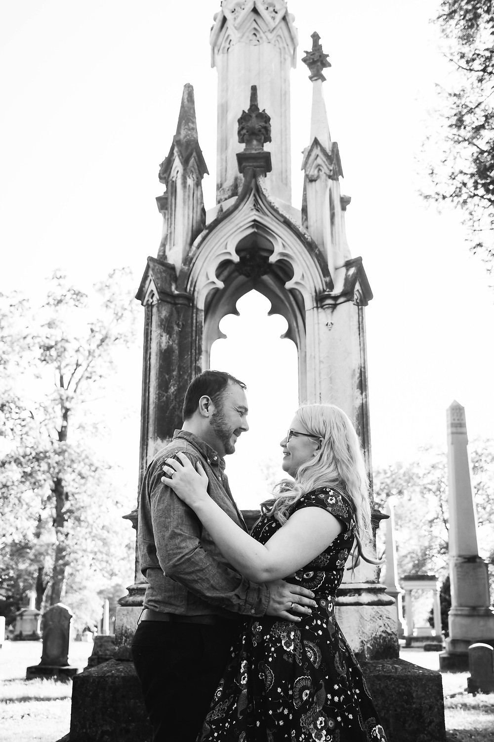 Black and white cute couple facing each other in cemetery at Mt. Olivet Cemetery