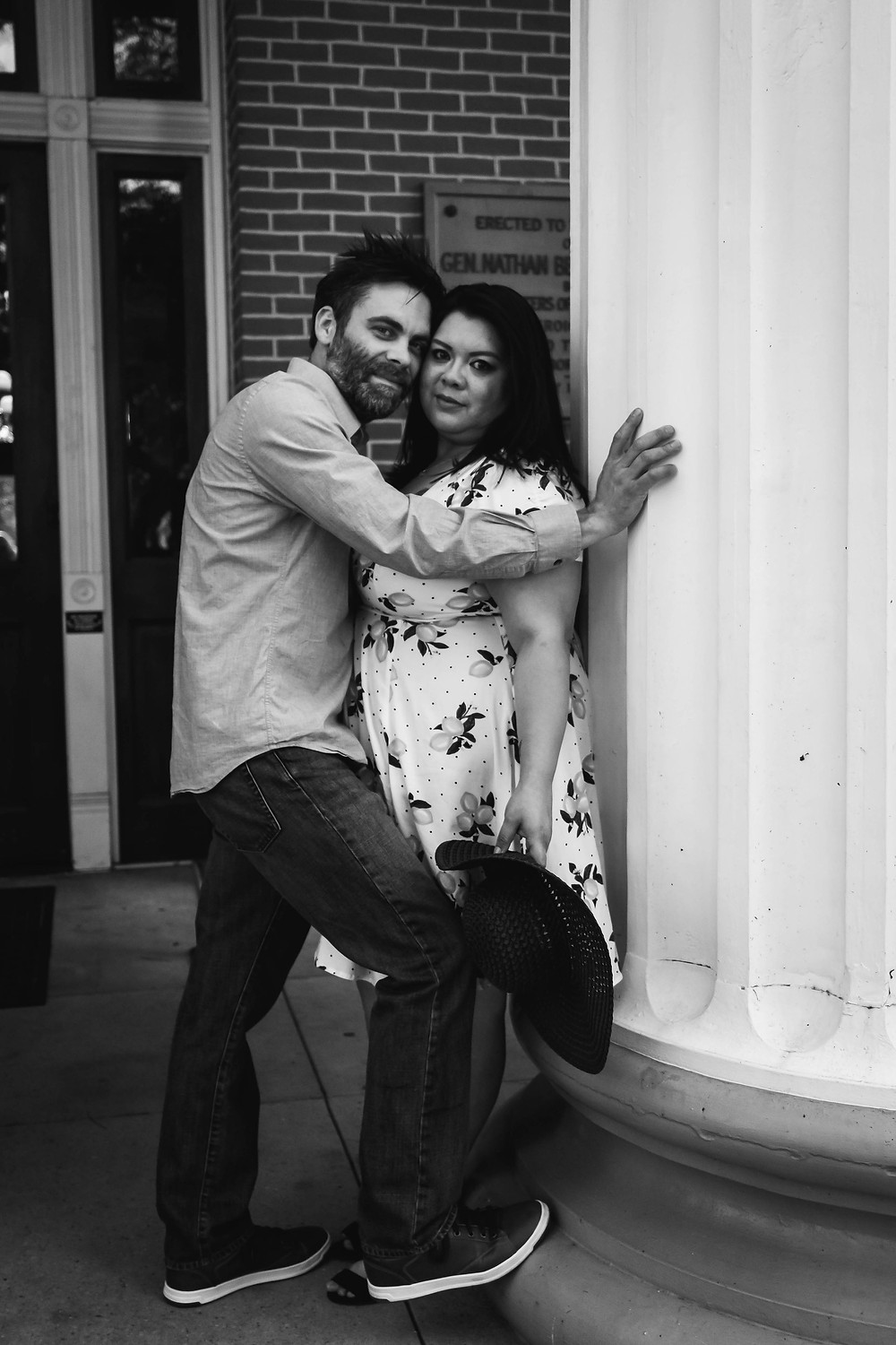 Black and white cute couple poses in downtown Murfreesboro
