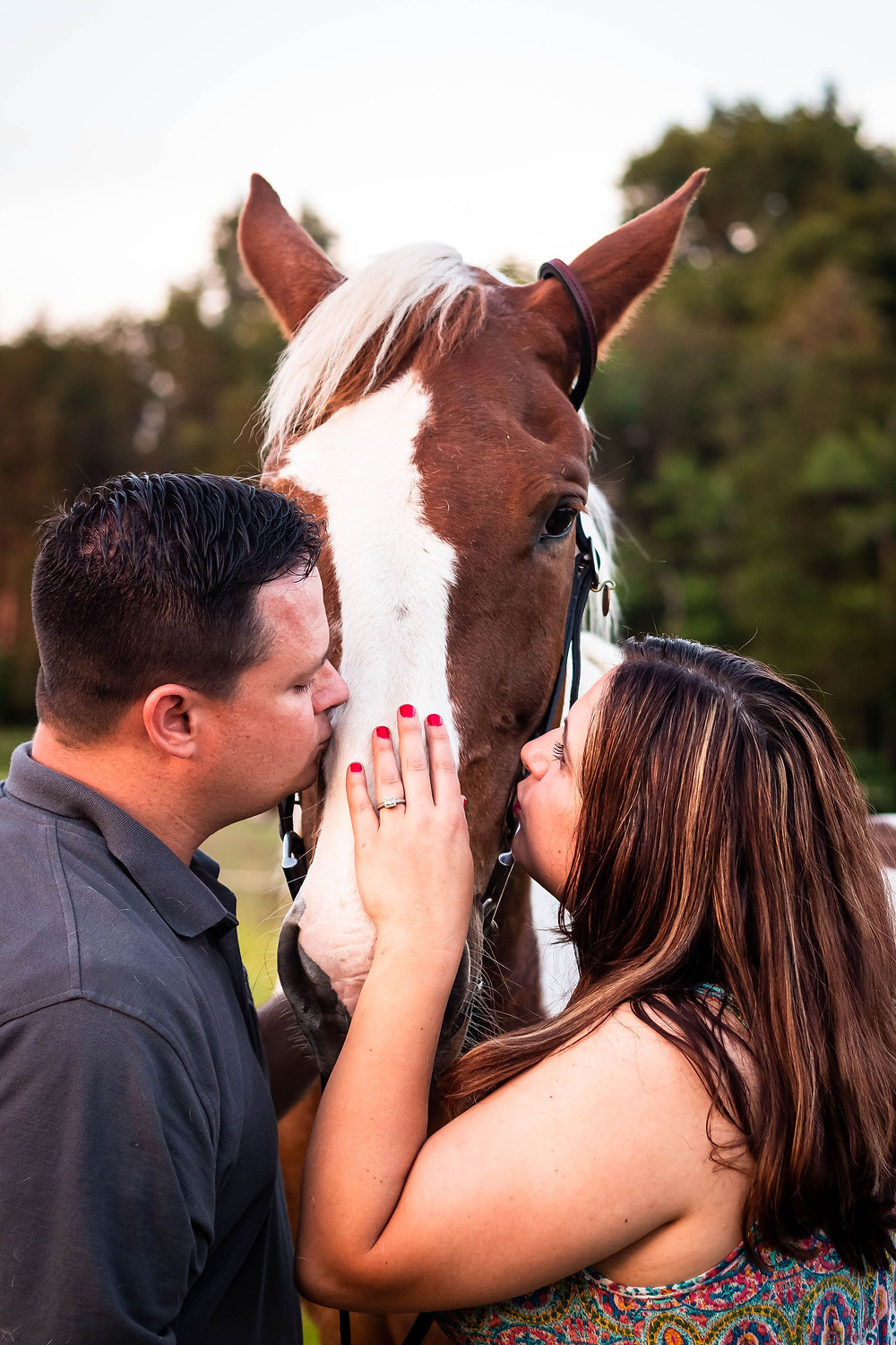 Cute couple give painted horse a kiss in Lewisburg, Tennessee