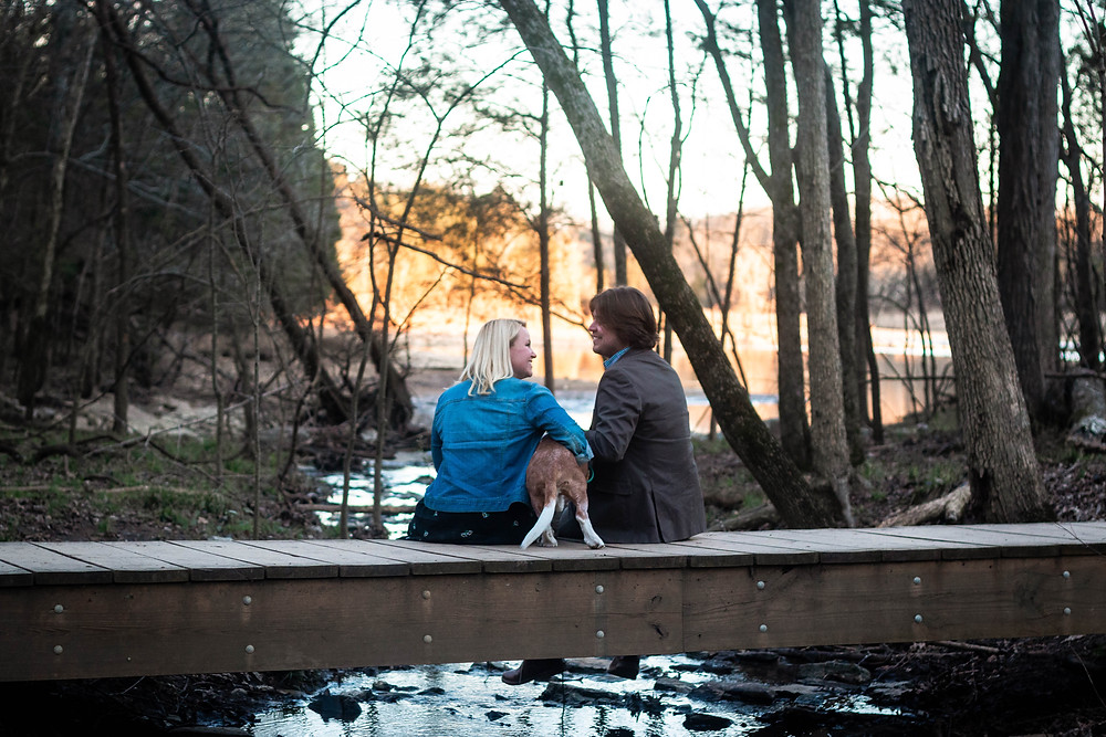 Cute couple sit on a bridge at Long Hunter State Park