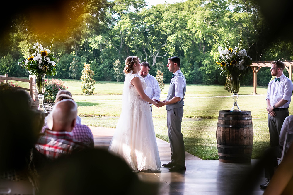 Bride and groom share vows at Sycamore Farm