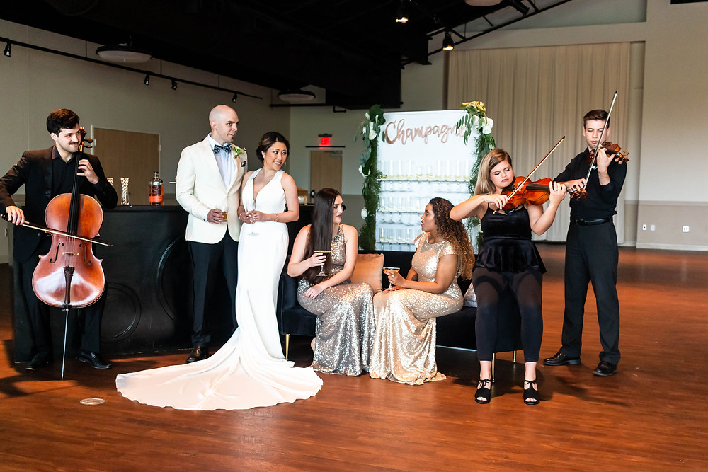 Bride and groom enjoy live music at reception at Noah Liff Opera Center