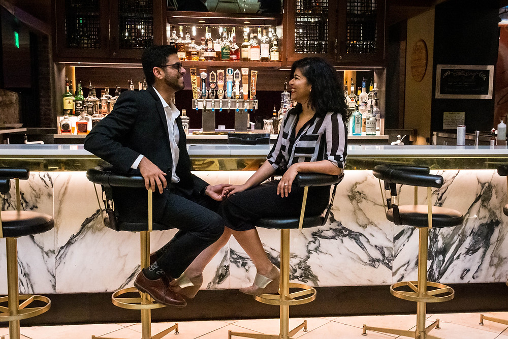 Cute couple share a laugh at a bar at Union Station Hotel
