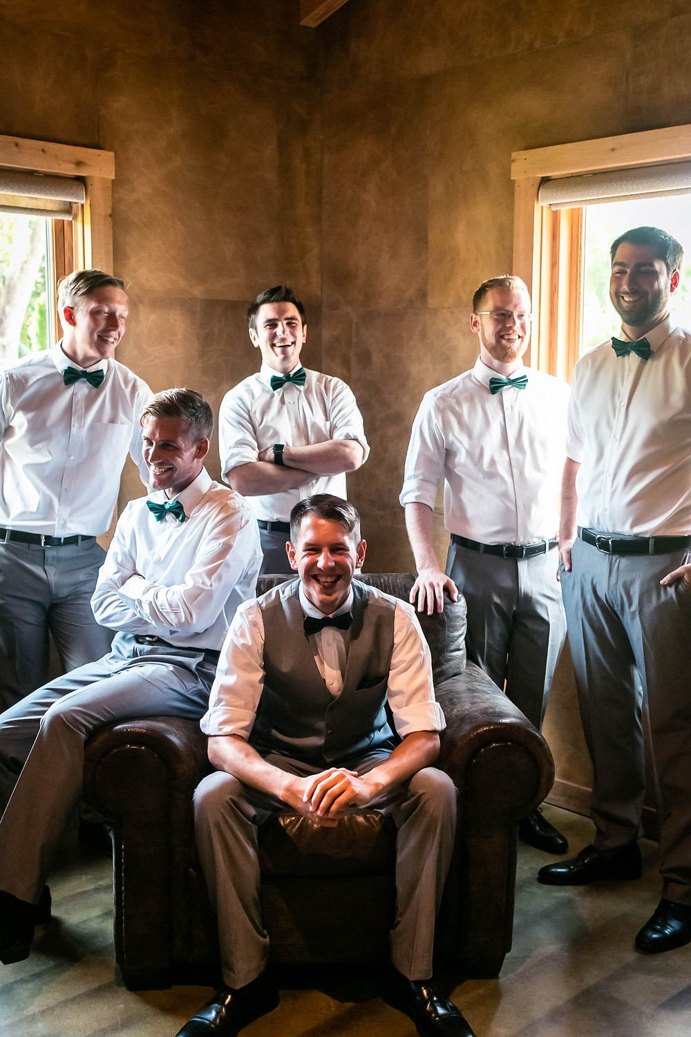 Groom surrounded by groomsmen at Sycamore Farm