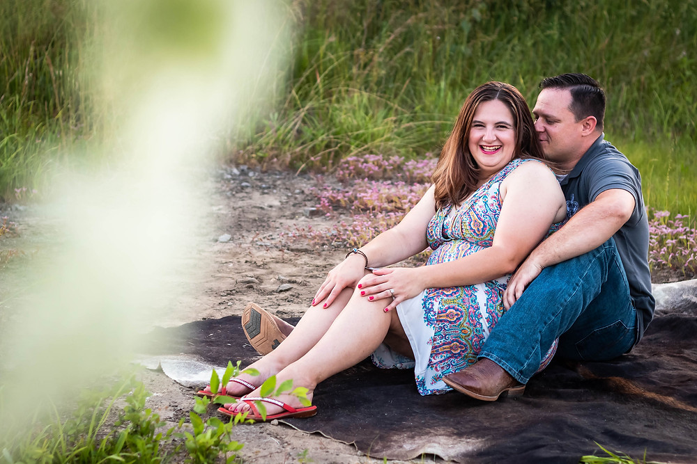 Cute couple sharing secrets in a field in Lewisburg, Tennessee