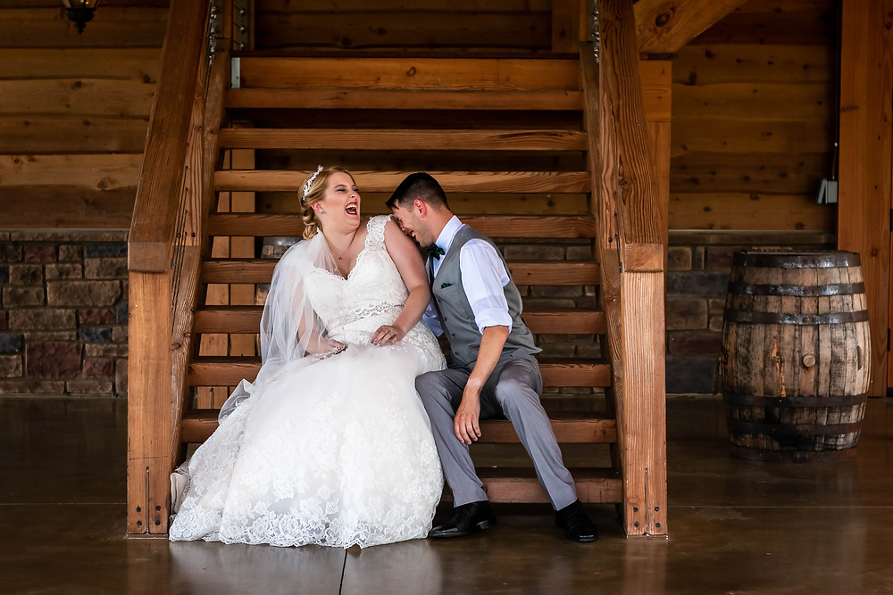 Bride and groom share a laugh at Sycamore Farm
