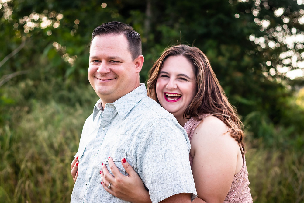 Cute couple share a laugh in a field in Lewisburg, Tennessee