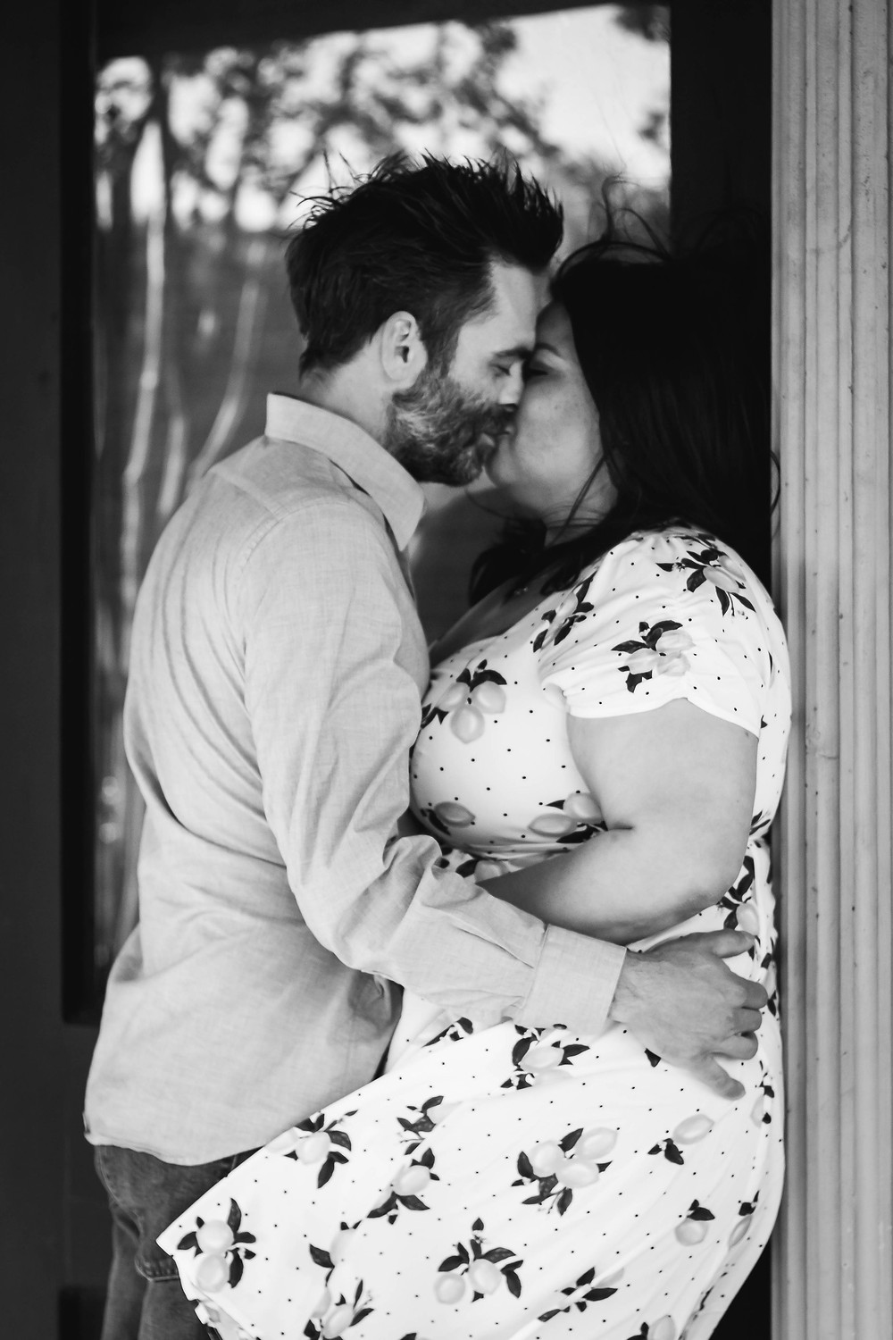 Black and white cute couple share a kiss  in downtown Murfreesboro