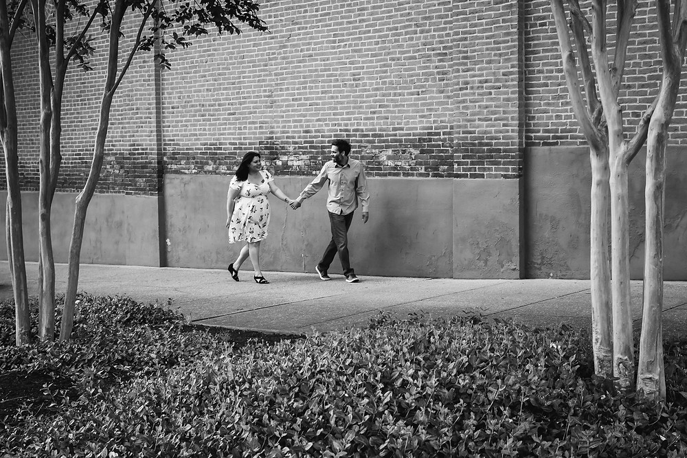 Black and white couple walking in downtown Murfreesboro