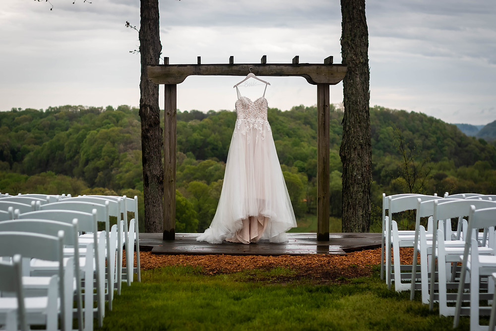 Detail shot of wedding dress with Tennessee mountains at Owen Farm